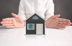 Mortgage concept by house from hand Royalty Free Stock Photo