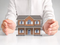 Mortgage concept by house from hand Stock Photos