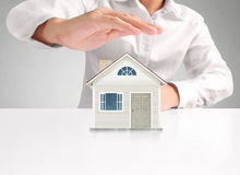 Mortgage concept by house from hand Royalty Free Stock Image