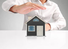 Mortgage concept by house from hand Stock Images