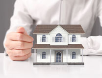 Mortgage concept by house from hand Royalty Free Stock Photography