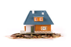 Mortgage concept - house on heap of money stock image