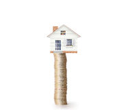 Mortgage concept by money house from  coins Stock Photo