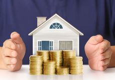 Mortgage concept by money house from coins Stock Images