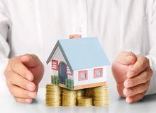 Mortgage concept by money house from coins Royalty Free Stock Photography