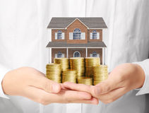 Mortgage concept by money house from coins Royalty Free Stock Images