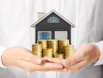 Mortgage concept by money house from coins Royalty Free Stock Photo