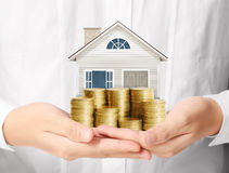 Mortgage concept by money house from coins stock photography