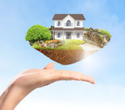 Mortgage concept by money house Stock Photos