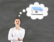 Mortgage concept with thinking man Stock Photo