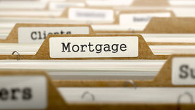 Mortgage Concept with Word on Folder Stock Photos