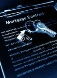 Mortgage contract. With keys under blue light Royalty Free Stock Images
