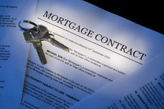 Mortgage contract. Photo of mortgage contract with house keys Stock Image