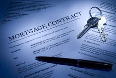 Mortgage contract. With keys and ballpoint pen Royalty Free Stock Images