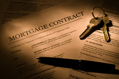 Mortgage contract. With keys and ballpoint pen Stock Photos