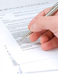 Mortgage Contract. Man examining mortgage contract with ballpoint pen Stock Photos