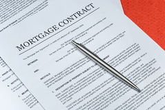 Mortgage Contract. Photo of Mortgage contract with ballpoint pen Stock Photo