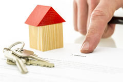Mortgage contract. Closeup of signing mortgage contract. Focus on word contract Stock Photography