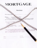 Mortgage. Contract entwined chain and pen. Contract entwined chain and pen Royalty Free Stock Image