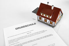Mortgage Contract - the German Word Grundschuld. Mortgage Contract - Concept with the German Word Grundschuld Royalty Free Stock Images