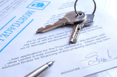 Mortgage contract signed closeup. Mortgage contract signed with detail of keys to buying a home closeup Royalty Free Stock Images