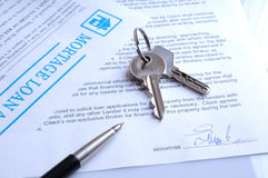 Mortgage contract signed. With detail of keys to buying a home Stock Image