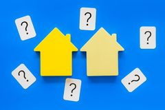 Mortgage credit concept with house toy and question mark on blue background top view stock photo