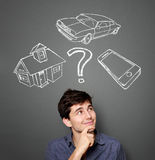 Mortgage and credit concept. Young man planning his future Royalty Free Stock Images