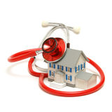 Mortgage Doctor. A model house is being doctored by a stethoscope Royalty Free Stock Images