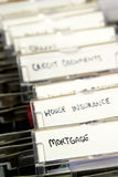 Mortgage documents. Detail of a filing cabinet with tabs labelled for mortgage documents, house insurance, etc Stock Images