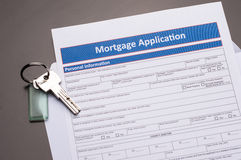 Mortgage Documents. With keys on gray table royalty free stock photo