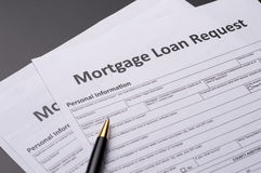 Mortgage Documents. With pen on gray table stock photo