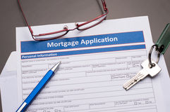Mortgage Documents. With pen, keys and glasses on gray table royalty free stock photos