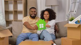 Happy couple with boxes moving to new home stock footage