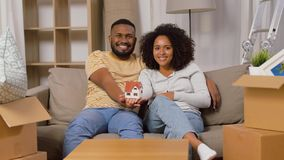 Happy couple with house model moving to new home stock video footage