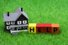 Mortgage Help. House with alphabet blocks spelling help � mortgage crisis Royalty Free Stock Images