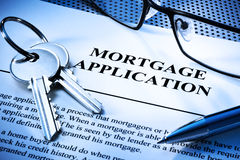Mortgage Home Loan Application. A still-life with a home loan mortgage application, keys, glasses and pen stock photography