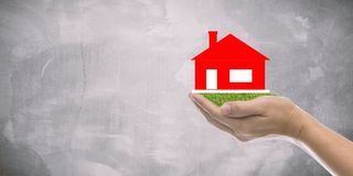 Home loan, house insurance. Mortgage home loan or house insurance concept. real estate broker hands holding  house with copy space Royalty Free Stock Photography