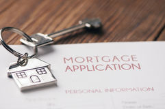 Mortgage. A house key sitting on mortgage application royalty free stock photography
