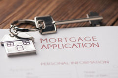 Mortgage. A house key sitting on mortgage application Stock Image