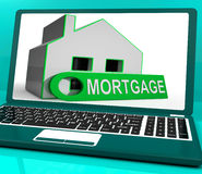 Mortgage House Laptop Shows Owing Money For Property Royalty Free Stock Photos