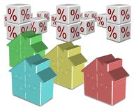Mortgage and interest rates. A group of colorful jigsaw puzzle houses and percentage symbols in the background Royalty Free Stock Images