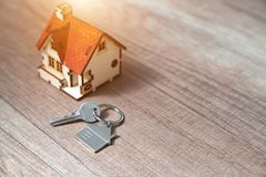 Mortgage, investment, real estate and property concept - close u. P of home model, money and house keys royalty free stock image
