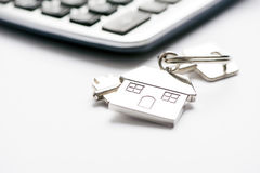 Mortgage. Key and house-shaped keyring and calculator - mortgage concept Stock Photo