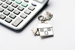 Mortgage. Key and house-shaped keyring and calculator - mortgage concept Royalty Free Stock Image
