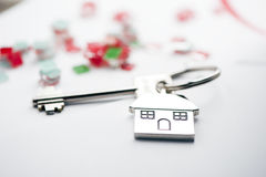 Mortgage. Key and house-shaped keyring and calculator - mortgage concept Royalty Free Stock Images