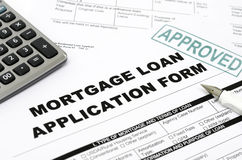 Mortgage loan. Application form and approved stamp stock photography