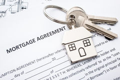 Mortgage loan agreement application. With house shaped keyring Royalty Free Stock Photo