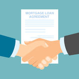 Mortgage loan agreement handshake. Concept of investment, risk and buying Stock Photo