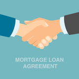 Mortgage loan agreement handshake. Concept of investment, risk and buying Royalty Free Stock Image
